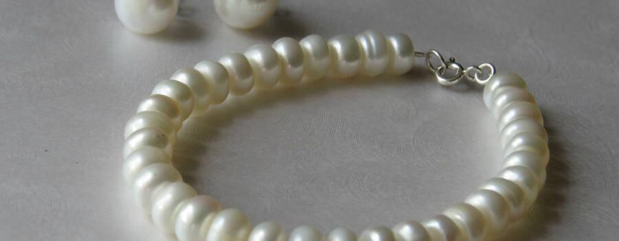 Solitario perlas planas