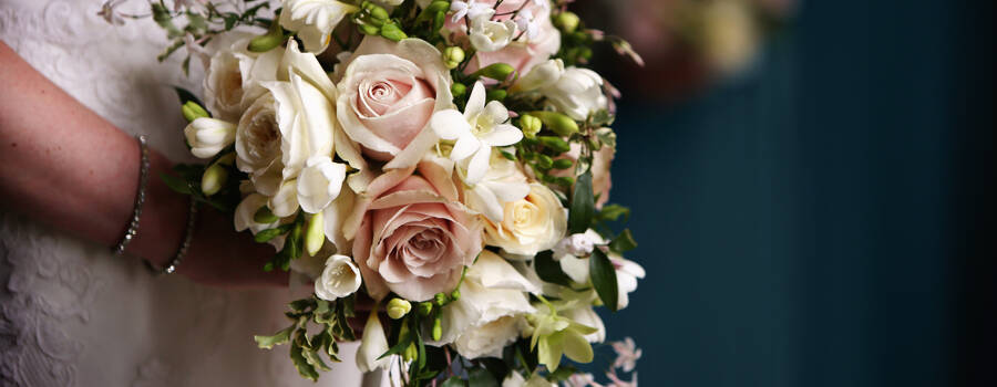 Bridal shower bouquet. A classic bouquet option up-dated with a shorter length of soft jasmine trails and on trend muted colours