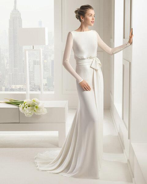 Robe de mariée à manches longues et noeud à la taille. Modèle Sal.