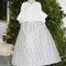 Vestido de novia 2014 Delpozo en color blanco con detalles metalizados, volumen sobre dimensionado en el corpiño y falda midi con mucha amplitud