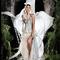 Vestido de novia largo con telas voluminosas en color blanco