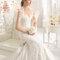 Pięknie zdobiona suknia ślubna, Foto: Rosa Clará 2015