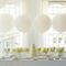 Decoración para mesa de postres 2013 en color blanco con flores en color amarillo y globos