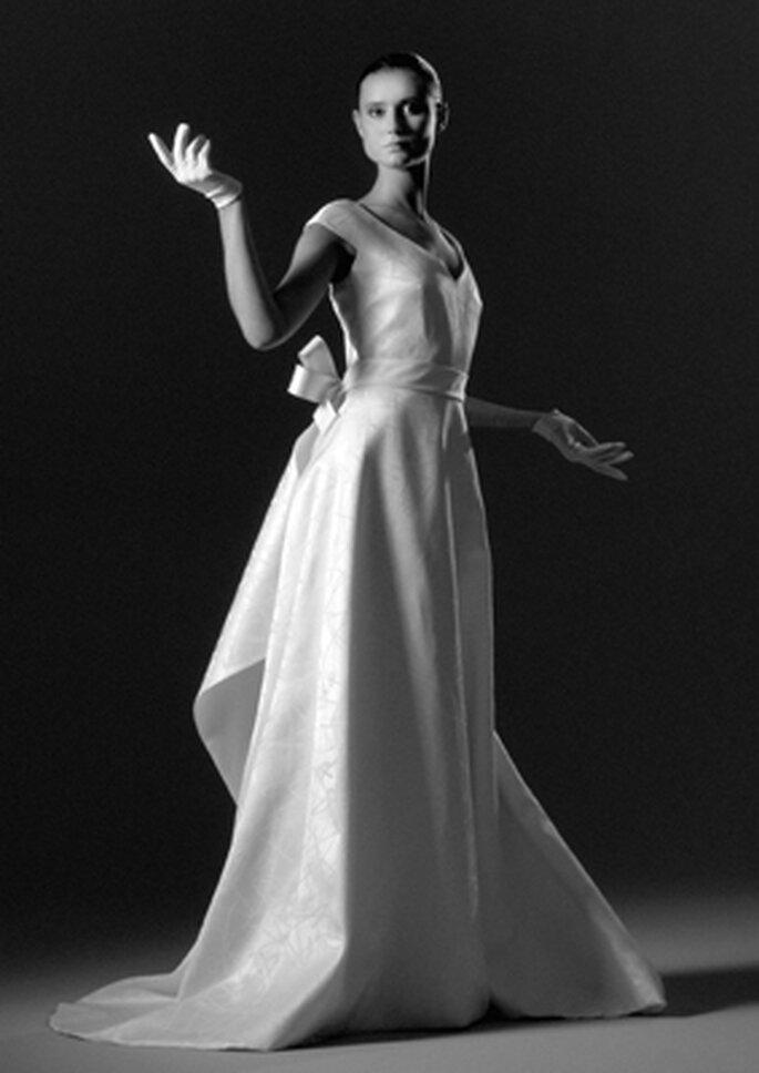 Reinaldo Alvarez : robe de mariée à dos portefeuille à volant
