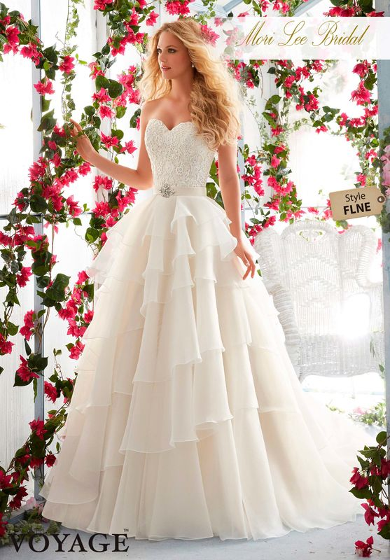 Dress Style FLNE   Venice Lace Appliques On The Asymmetrically Tiered, Organza Gown  Removable Beaded Satin Belt. Colors available: White, Ivory, Ivory/Champagne.
