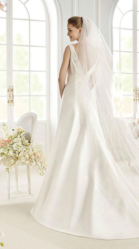 Beispiel: Brautmode, Foto: Diva Braut- und Festmoden.