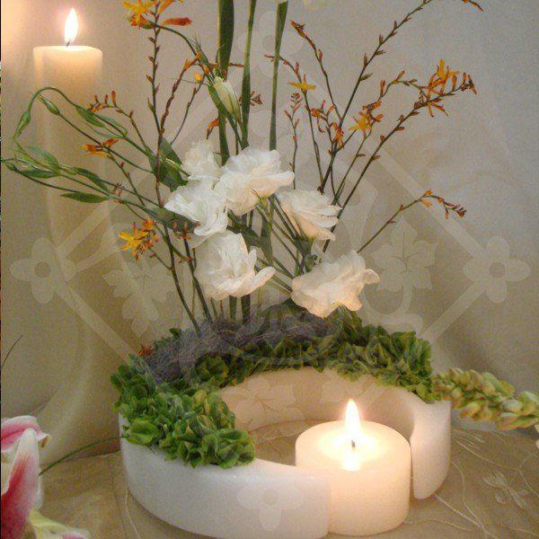 Centro de mesa de boda decorado con velas; Velas Saviñon
