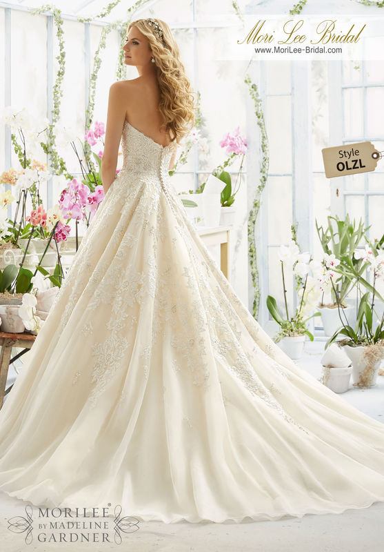 Dress Style OLZL Pearl And Crystal Beading On Elegant Embroidery That Decorates The Classic Tulle Ball Gown  Colors available: White, Ivory, Champagne.