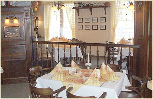 Beispiel: Innenraum, Foto: Restaurant Am Löwenplatz.