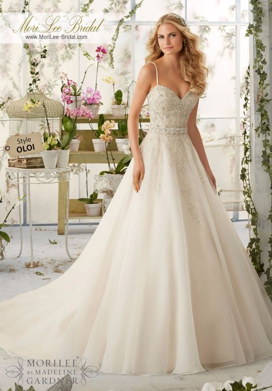 Dress Style OLOI Crystal Beaded Embroidery Cascades Onto The Organza Ball Gown With Shoestring Straps  Removable Beaded Satin Belt. Colors available: White/Silver, Ivory/Silver, Ivory/Light Gold/Silver, Ivory/Blush/Silver.
