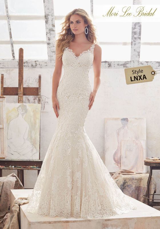 Dress style LNXA Marcelline Wedding Dress Availalble in Three Lengths: 55″, 58″, 61″. Colors Available: White, Ivory, Ivory/Champagne. Shown in Ivory/Champagne.