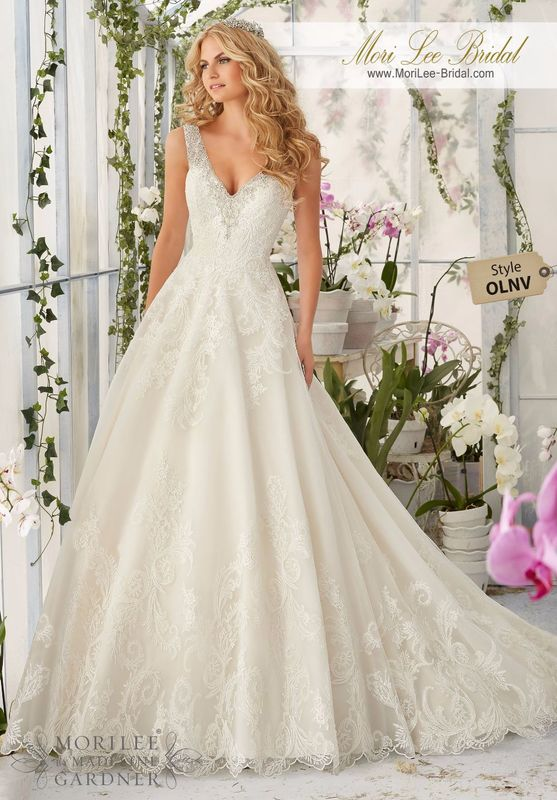 """Dress Style OLNV Diamante Beading Edges The Tulle Ball Gown Decorated With Wispy, Embroidered Lace Appliques And Deep Scalloped Edging  Available in Three Lengths: 55"""", 58"""", 61"""". White/Silver, Ivory/Silver, Ivory/Light Gold/Silver, Ivory/Blush/Silver."""