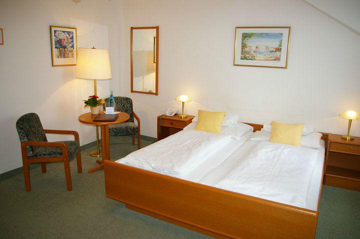 Beispiel: Hotelzimmer, Foto: Inselhotel Faakersee.