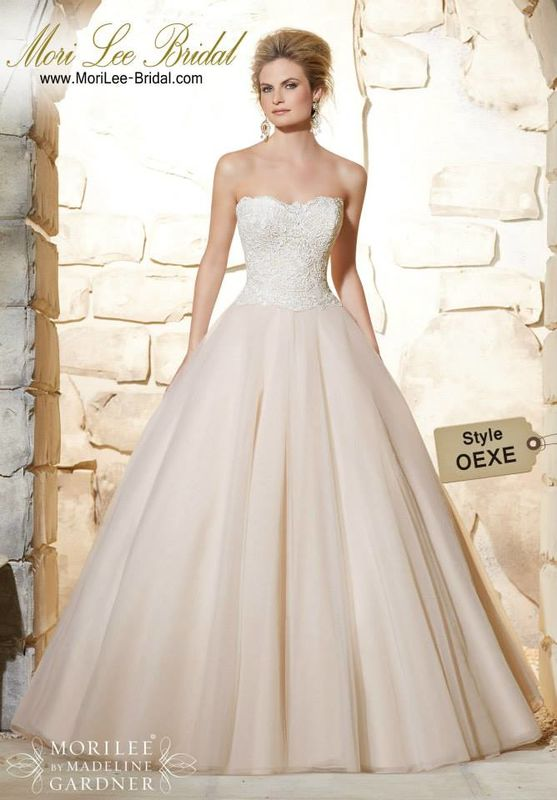 Dress Style OEXE Elegant Venice Lace Bodice Onto The Classic Tulle Ball Gown  An exquisite Venice lace bodice makes this this timeless bridal ballgown simply stunning. Colors Available: White, Ivory, Caramel