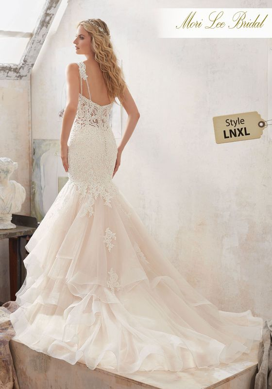 Dress style LNXL Marciela Wedding Dress Available in Three Lengths: 55″, 58″, 61″. Colors Available: White, Ivory, Ivory/Champagne. Shown in Ivory/Champagne.