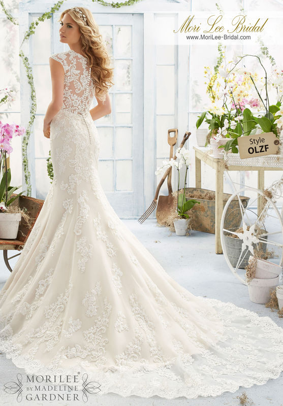 """Dress Style OLZF Crystal Beaded Embroidered Appliques And Scalloped Hemline On a Net Gown With Sheer Train  Available in Three Lengths: 55"""", 58"""", 61"""". Colors Available: White, Ivory, Light Gold."""