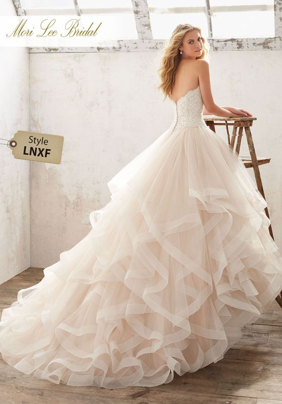 Dress style LNXF Marcia Wedding Dress Availalble in Three Lengths: 55″, 58″, 61″. Colors Available: White, Ivory, Ivory/Champagne. Shown in Ivory/Champagne.