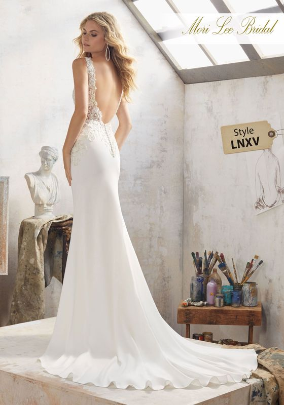 Dress style LNXV Mallory Wedding Dress Colors Available: Ivory/Silver. Shown in Ivory/Silver.
