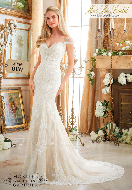 Dress Style OLYI  EMBROIDERED APPLIQUES ON SOFT NET TRIMMED WITH DIAMANTE BEADING  Removable Tulle Overskirt included. Available in Three Lengths: 55 , 58 , 61 . Colors Available: White/Silver, Ivory/Silver, Light Gold/Silver