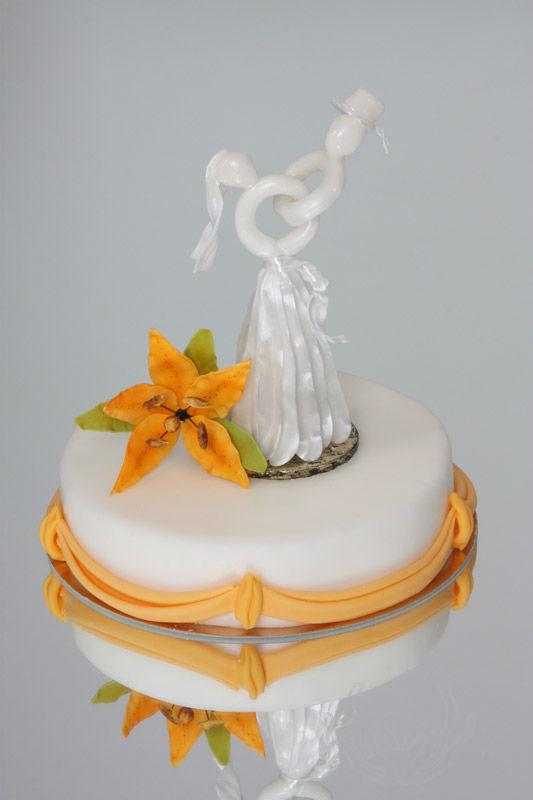 Beispiel: Hochzeitstorte, Foto: Tortenkunstwerke.