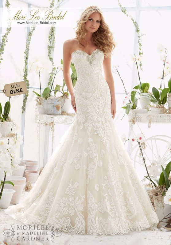 """Dress Style OLNE Crystal Moonstone Beading Trims The Tulle Gown With Embroidered Appliques And Scalloped Hemline  Available in Three Lengths: 55"""", 58"""", 61"""". Colors available: White/Silver, Ivory/Silver, Light Gold/Silver."""