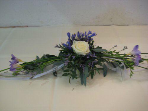 Beispiel: Blumenschmuck für die Hochzeitstische, Foto: Blumenstüberl Helmut Frick.