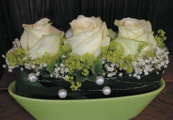Beispiel: Dekoration Ihrer Hochzeitslocation, Foto: Haus Blumengeschäft und Gärtnerei.