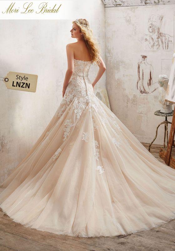 Dress style LNZN Mackenzie Wedding Dress Colors Available: White, Ivory, Ivory/Caramel. Shown in Ivory/Caramel.