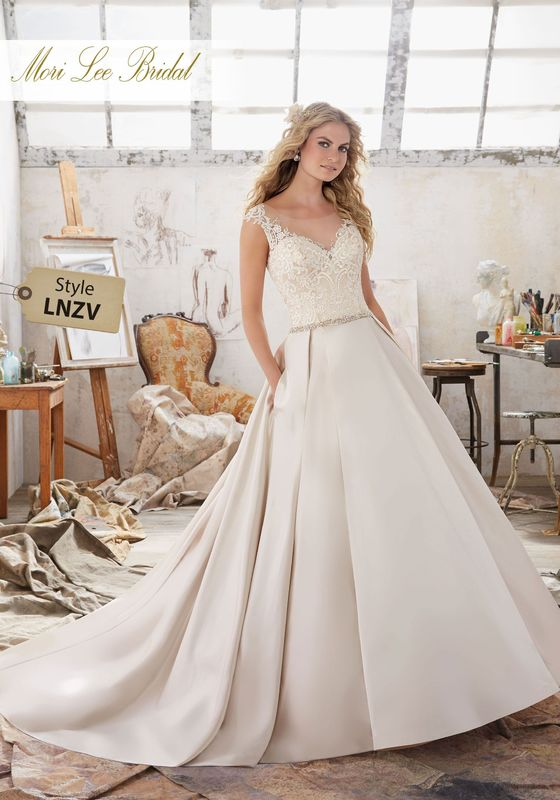 Dress style LNZV Maclaine Wedding Dress  Colors Available: White, Ivory, Champagne. Shown in Champagne.