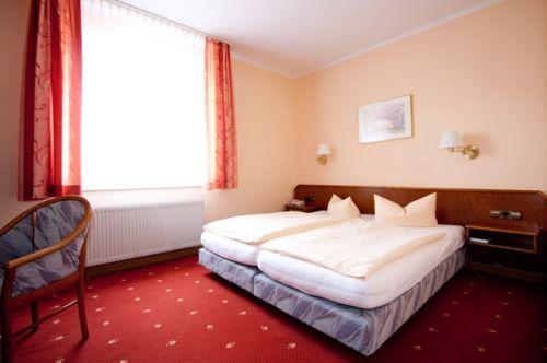 Beispiel: Doppelzimmer, Foto: AKZENT Hotel Am Husarenhof.