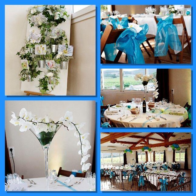 décoration de salle en turquoise et vert anis. Création de composition florale. Plan de table sous forme de mur floral.