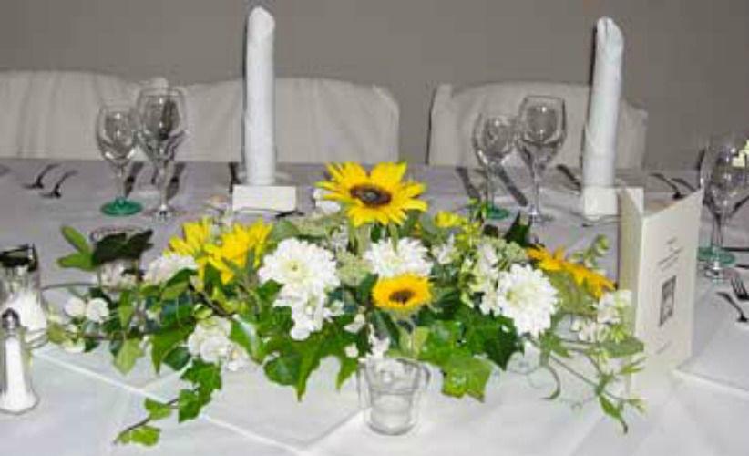 Beispiel: Tischdekoration, Foto: Der Blumenladen.