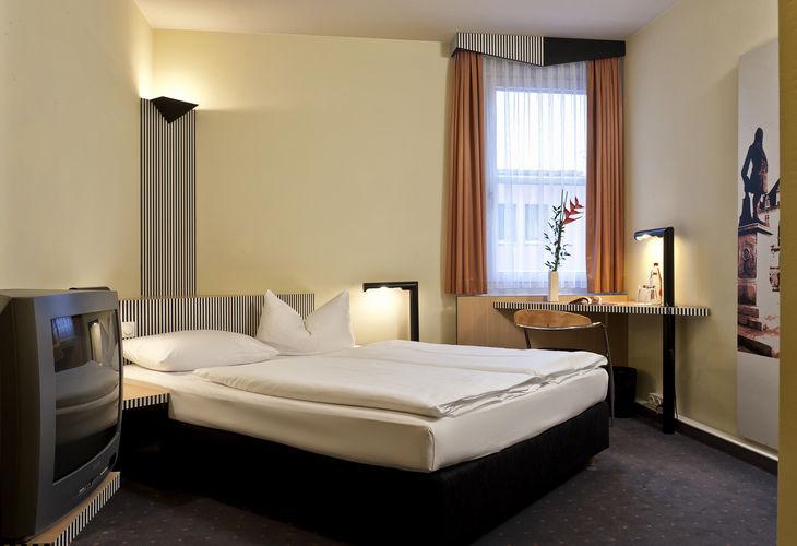 Beispiel: Doppelzimmer, Foto: Grand City Hotel Halle.