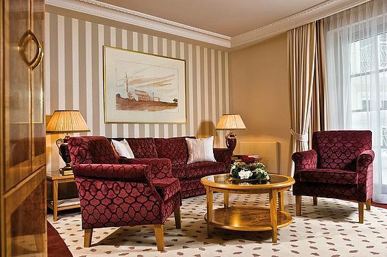 Beispiel: Suite Wohnzimmer, Foto: Travel Charme Strandidyll Heringsdorf.