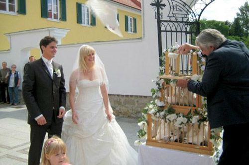 Beispiel: Umrahmung des Hochlass mit einem Gedicht, Foto: Hochzeitstauben.