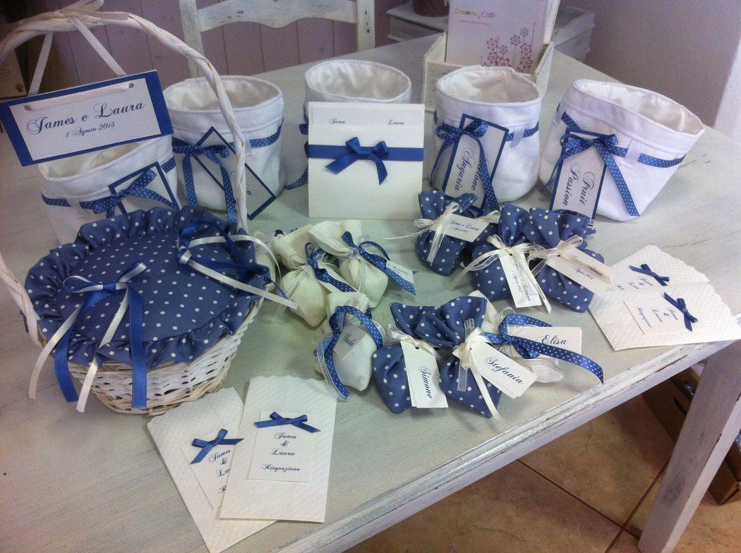 Matrimonio blu pois blu avio, cestino portafedi, invito e bomboniere  atema blu