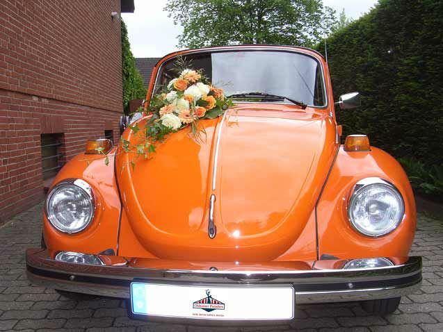 Beispiel: VW Käfer Cabrio in Orange, Foto: Oldtimer Paradies.