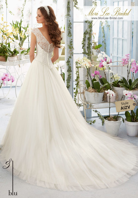Dress Style AIZV Embroidered Lace Overlays The Bateau Bodice On The Soft Net Ball Gown  Colors available: White, Ivory, Ivory/Blush.
