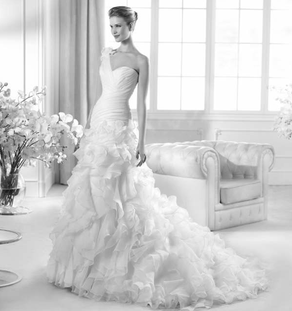Beispiel: Wunderschönes Brautkleid, Foto: Brautstudio Sposa Favola.