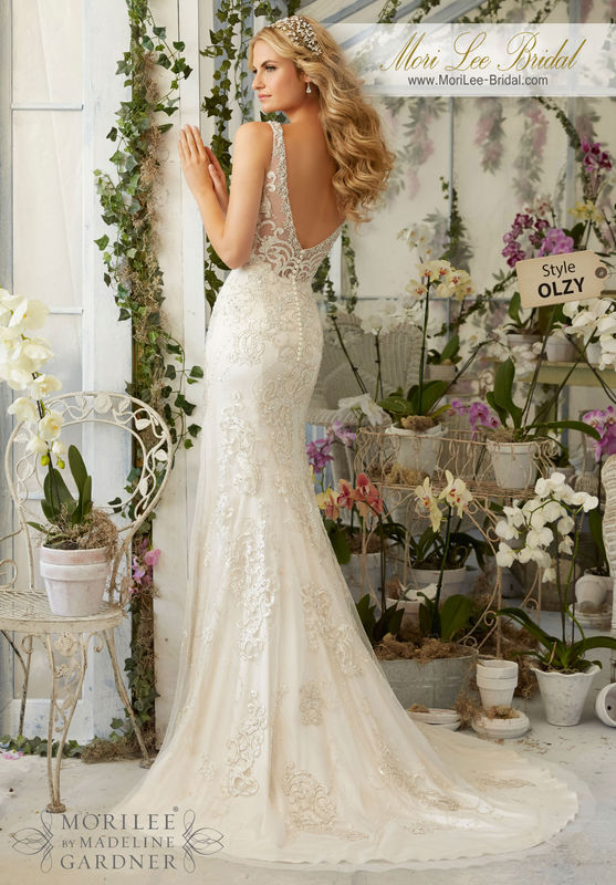 Dress Style OLZY Crystal Beading On Laser Cut, Embroidered Appliques Onto The Net Gown Over Soft Satin  Colors Available: White/Silver, Ivory/Silver, Light Gold/Silver.