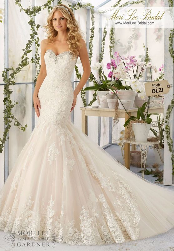 """Dress Style OLZI Crystal Beaded Embroidery Meets The Cascading Alencon Lace Appliques And Scalloped Hemline Edging The Tulle Train Inset  Available in Three Lengths: 55"""", 58"""", 61"""". Colors Available: White/Silver, Ivory/Silver, Light Gold/Silver."""