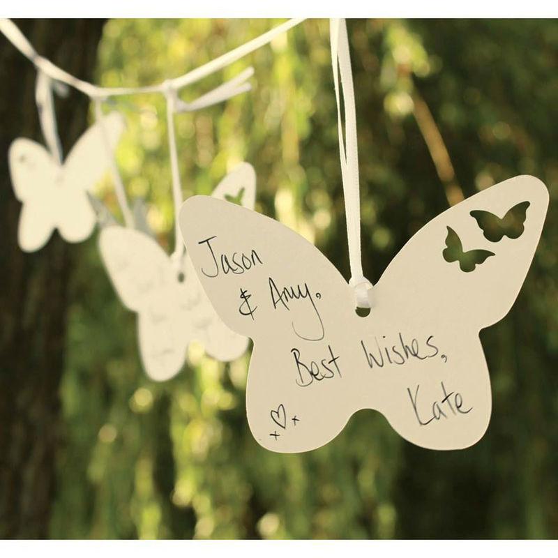 Pide a tus invitados que te dejen un mensaje de felicitación en estas mariposas