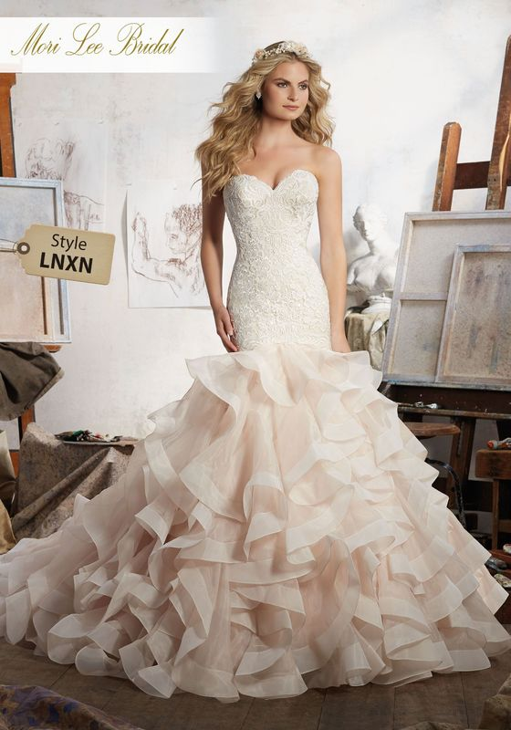 Dress style LNXN Maisie Wedding Dress Available in Three Lengths: 55″, 58″, 61″. Colors Available: White, Ivory, Ivory/Caramel. Shown in Ivory/Caramel.