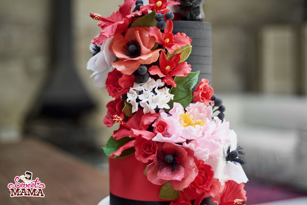 Cascada de flores en tonos rojos. Foto: Haut Touch Studio.