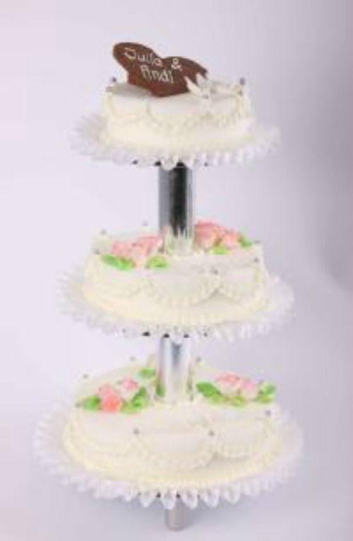 Beispiel: Hochzeitstorte: Taubenliebe, Foto: Beck Lyner.