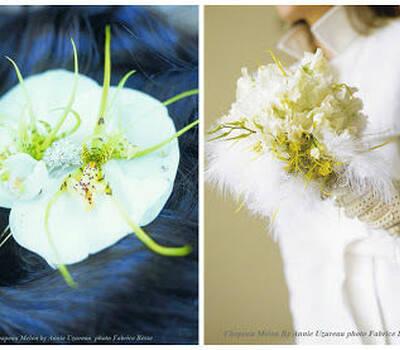 une épingle à cheveux et un bouquet de mariée en pois de senteur et plumes