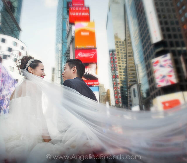 Wedding photo in Time Square, New York City by Angelica Roberts Photography