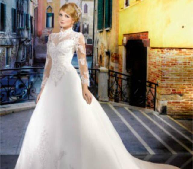 Beispiel: Hochzeitskleid, Foto: Bea´s Hochzeits- und Fest- Boutique.