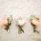 Organize mini bouquets with a rose and some branches .