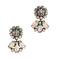 Aretes de diamantes y piedras preciosas en colores neutros para agregar a tu mesa de regalos Zankyou para San Valentín